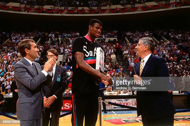 David Robinson of the San Antonio Spurs shakes hands with Commissioner David Stern while getting an award before a game circa 1991 in San Antonio...