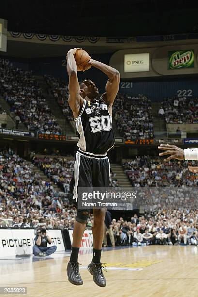 David Robinson of the San Antonio Spurs shoots against the New Jersey Nets in Game three of the 2003 NBA Finals at Continental Airlines Arena on June...