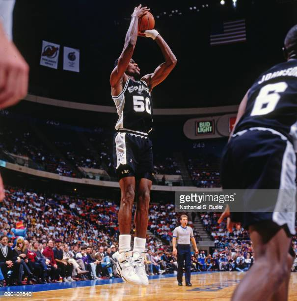 David Robinson of the San Antonio Spurs shoots the ball during the game against the New Jersey Nets circa 1993 at the Brendan Byrne Arena in East...