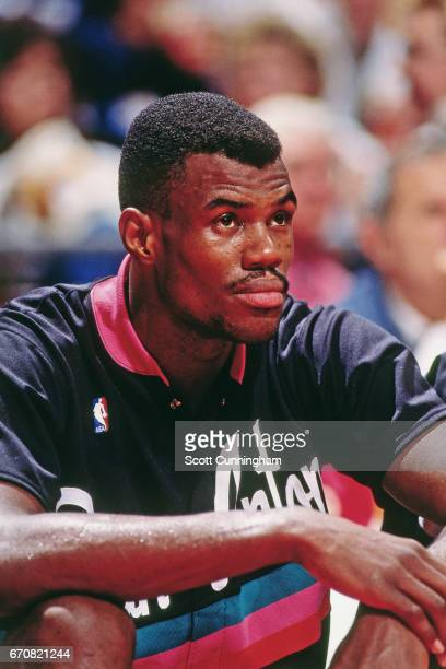 David Robinson of the San Antonio Spurs sits on the bench against the Atlanta Hawks during a game played circa 1990 at the Omni in Atlanta Georgia...