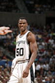 David Robinson of the San Antonio Spurs smiles in Game one of the 2003 NBA Finals against the New Jersey Nets at SBC Center on June 4 2003 in San...