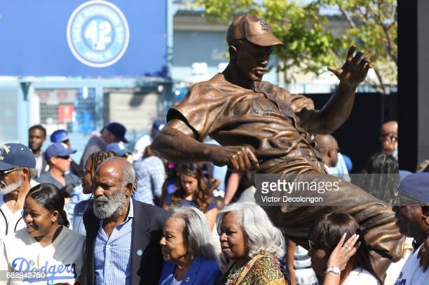 David Robinson Rachel Robinson and Sharon Robinson pose for a photo in front of the Jackie Robinson Statue after its unveiling at Dodger Stadium on...