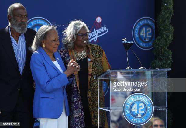 David Robinson Rachel Robinson and Sharon Robinson react onstage after the unveiling of the Jackie Robinson statue at Dodger Stadium on April 15 2017...