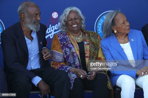 David Robinson Sharon Robinson and Rachel Robinson sit onstage during the Los Angeles Dodgers Jackie Robinson statue unveiling at Dodger Stadium on...