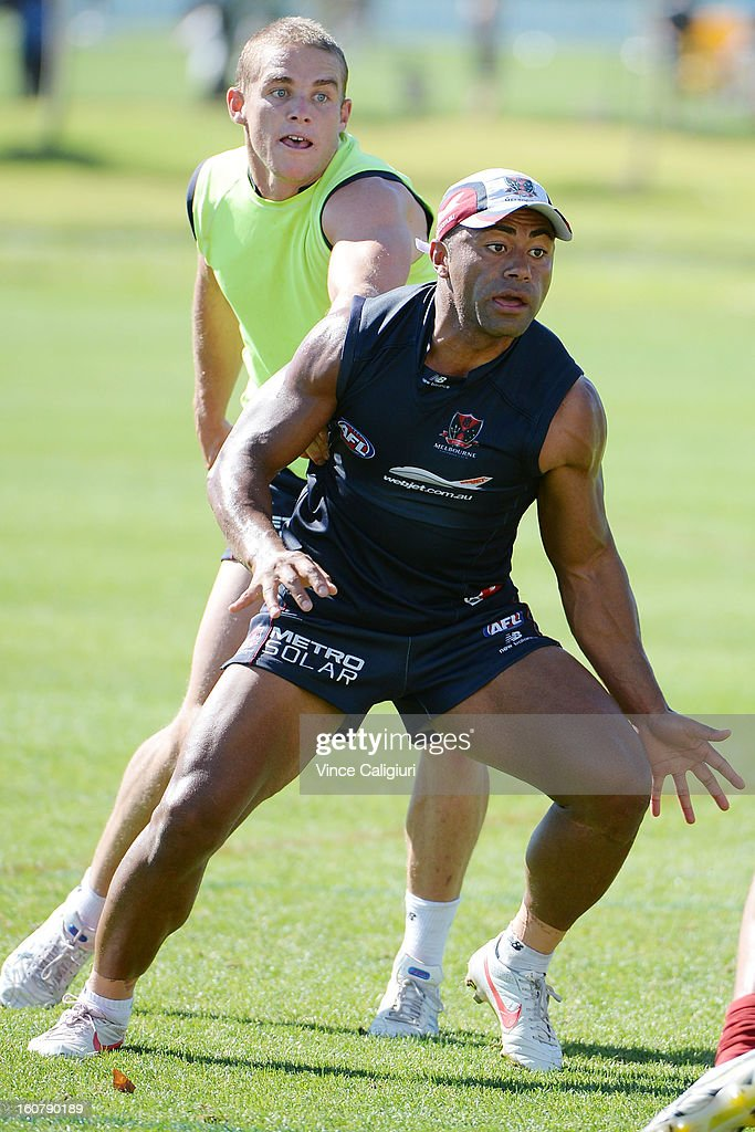 <a gi-track='captionPersonalityLinkClicked' href=/galleries/search?phrase=David+Rodan&family=editorial&specificpeople=240461 ng-click='$event.stopPropagation()'>David Rodan</a> looks to tackle during a Melbourne Demons AFL training session at Gosch's Paddock on February 6, 2013 in Melbourne, Australia.