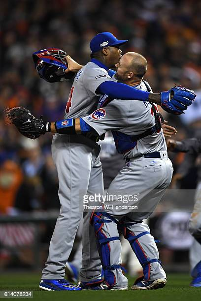David Ross and Aroldis Chapman of the Chicago Cubs celebrate after defeating the San Francisco Giants 65 in Game Four of their National League...