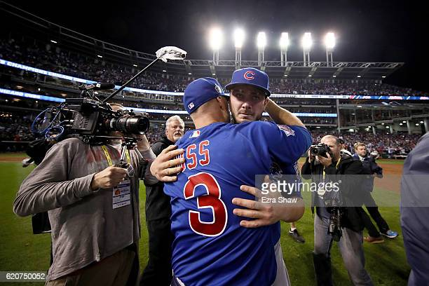 David Ross and Kris Bryant of the Chicago Cubs celebrate after defeating the Cleveland Indians 87 in Game Seven of the 2016 World Series at...
