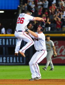 David Ross of the Atlanta Braves celebrates with Dan Uggla after knocking in the gamewinning run in the 10th inning against the Pittsburgh Pirates at...
