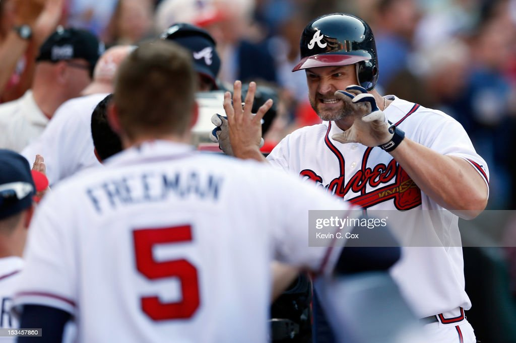 <a gi-track='captionPersonalityLinkClicked' href=/galleries/search?phrase=David+Ross&family=editorial&specificpeople=210843 ng-click='$event.stopPropagation()'>David Ross</a> #8 of the Atlanta Braves reacts as he heads back to the dugout after hitting a two-run home run in the second inning against the St. Louis Cardinals during the National League Wild Card playoff game at Turner Field on October 5, 2012 in Atlanta, Georgia.