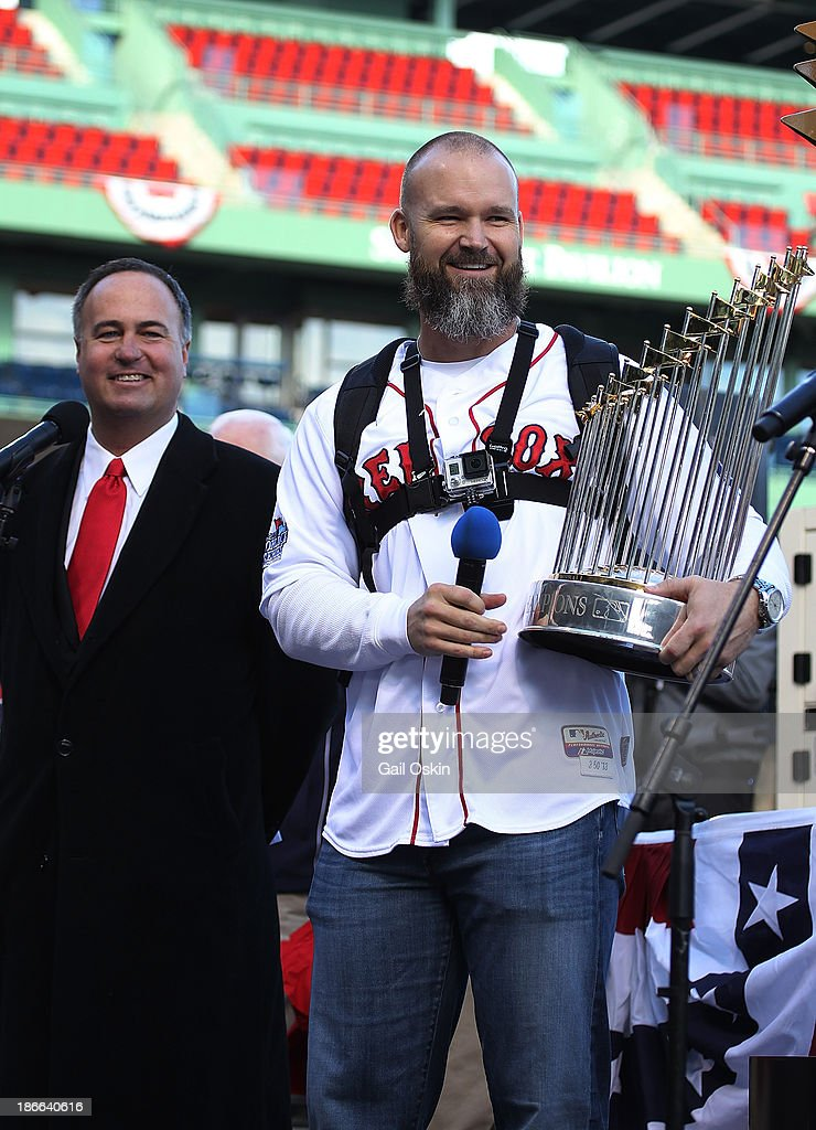David Ross of the Boston Red Sox addresses the crowd at Fenway Park before the Red Sox players board the duck boats for the World Series victory parade for the Boston Red Sox on November 2, 2013 in Boston, Massachusetts.