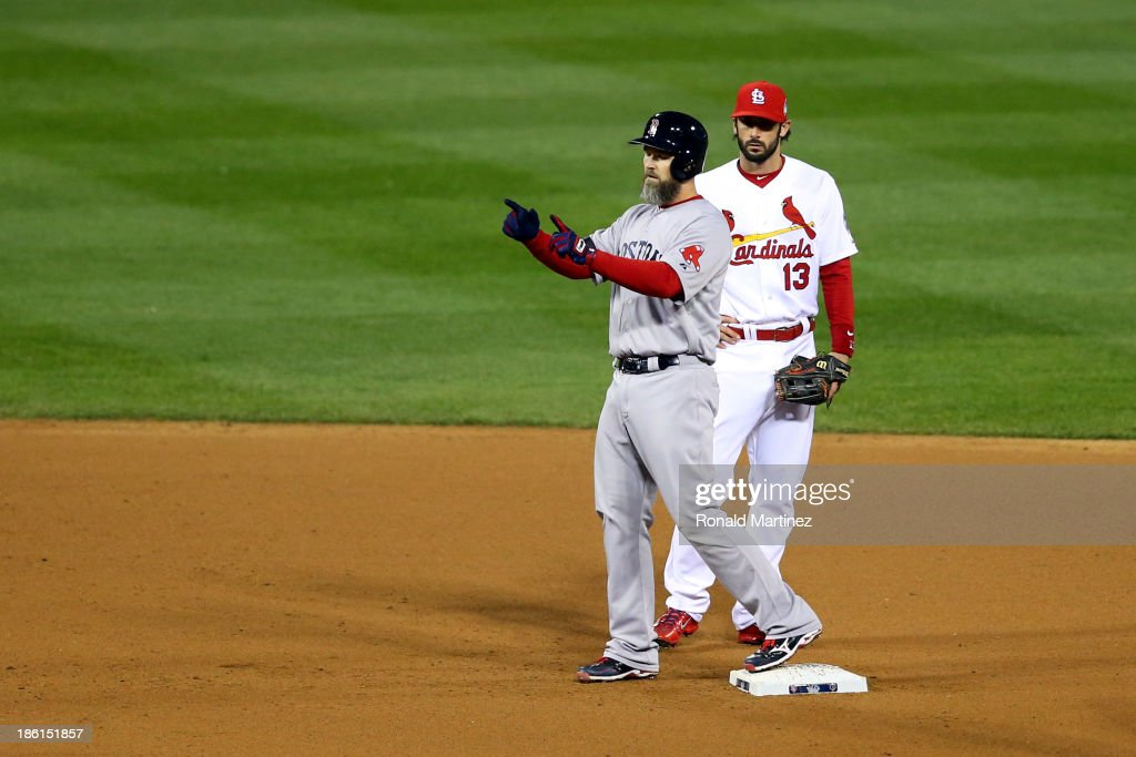 <a gi-track='captionPersonalityLinkClicked' href=/galleries/search?phrase=David+Ross&family=editorial&specificpeople=210843 ng-click='$event.stopPropagation()'>David Ross</a> #3 of the Boston Red Sox celebrates his RBI ground rule double scoring Xander Bogaerts #72 on second as Matt Carpenter #13 of the St. Louis Cardinals looks on in the seventh inning of Game Five of the 2013 World Series at Busch Stadium on October 28, 2013 in St Louis, Missouri.