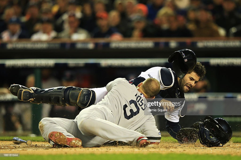 David Ross of the Boston Red Sox is out at home by Alex Avila of the Detroit Tigers in the second inning of Game Five of the American League...