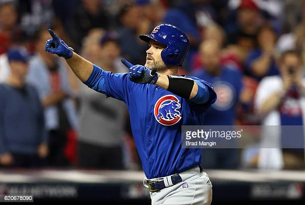 David Ross of the Chicago Cubs celebrates after hitting a solo home run in the sixth inning during Game 7 of the 2016 World Series against the...