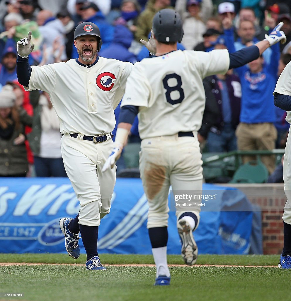 <a gi-track='captionPersonalityLinkClicked' href=/galleries/search?phrase=David+Ross&family=editorial&specificpeople=210843 ng-click='$event.stopPropagation()'>David Ross</a> #3 of the Chicago Cubs celebrates getting the game-winning hit, a single in the 11th inning, with teammate <a gi-track='captionPersonalityLinkClicked' href=/galleries/search?phrase=Chris+Coghlan&family=editorial&specificpeople=4391543 ng-click='$event.stopPropagation()'>Chris Coghlan</a> #8 against the Kansas City Royals at Wrigley Field on May 31, 2015 in Chicago, Illinois. The Cubs defeated the Royals 2-1 in 11 innings.
