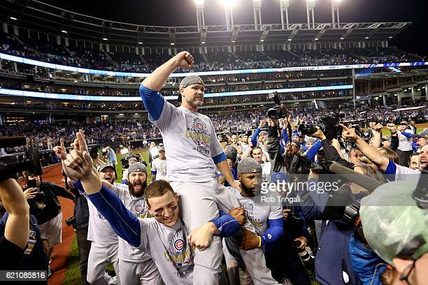 David Ross of the Chicago Cubs celebrates on the field with his teammates after defeating the Cleveland Indians in Game 7 of the 2016 World Series at...