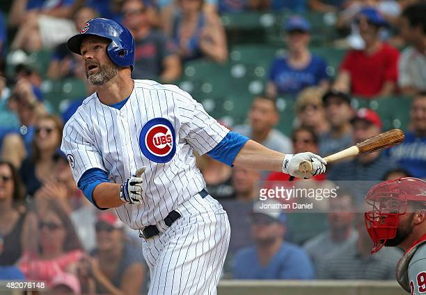 David Ross of the Chicago Cubs hits a home run in the 9th inning after pitching a scoreless inning 9th inning against the Philadelphia Phillies at...