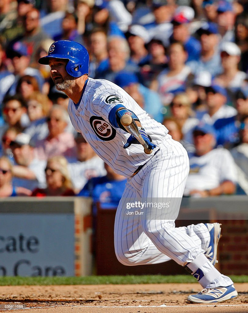 David Ross #3 of the Chicago Cubs hits a single against the Los Angeles Dodgers during the second inning at Wrigley Field on May 30, 2016 in Chicago, Illinois.