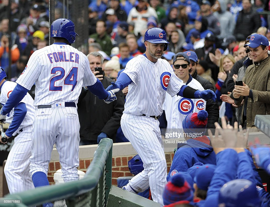 <a gi-track='captionPersonalityLinkClicked' href=/galleries/search?phrase=David+Ross&family=editorial&specificpeople=210843 ng-click='$event.stopPropagation()'>David Ross</a> #3 of the Chicago Cubs is greeted by <a gi-track='captionPersonalityLinkClicked' href=/galleries/search?phrase=Dexter+Fowler&family=editorial&specificpeople=4949024 ng-click='$event.stopPropagation()'>Dexter Fowler</a> #24 after hitting a home run against the Milwaukee Brewers during the second inning on April 28, 2016 at Wrigley Field in Chicago, Illinois.