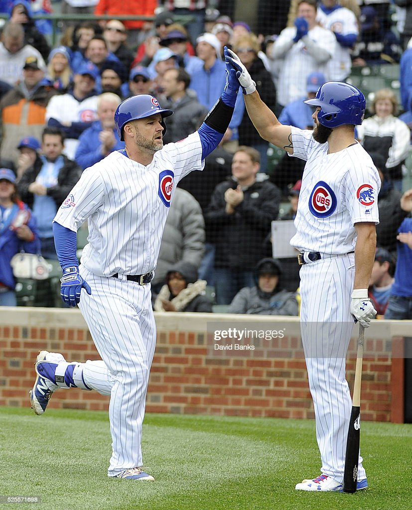 <a gi-track='captionPersonalityLinkClicked' href=/galleries/search?phrase=David+Ross&family=editorial&specificpeople=210843 ng-click='$event.stopPropagation()'>David Ross</a> #3 of the Chicago Cubs is greeted by <a gi-track='captionPersonalityLinkClicked' href=/galleries/search?phrase=Jake+Arrieta&family=editorial&specificpeople=5437045 ng-click='$event.stopPropagation()'>Jake Arrieta</a> #49 after hitting a home run against the Milwaukee Brewers during the second inning on April 28, 2016 at Wrigley Field in Chicago, Illinois.
