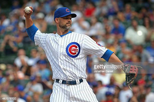 David Ross of the Chicago Cubs normally a catcher pitches a scoreless 9th inning against the Philadelphia Phillies at Wrigley Field on July 26 2015...