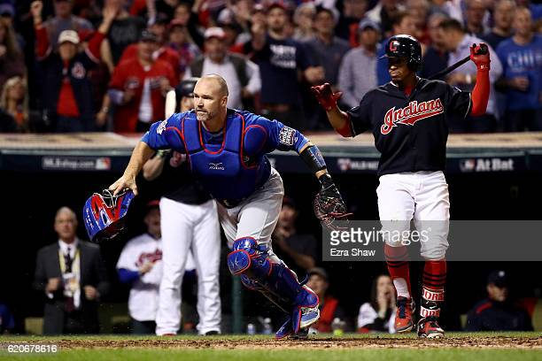 David Ross of the Chicago Cubs reacts after Jon Lester threw a wild pitch during the fifth inning allowing Jason Kipnis and Carlos Santana of the...