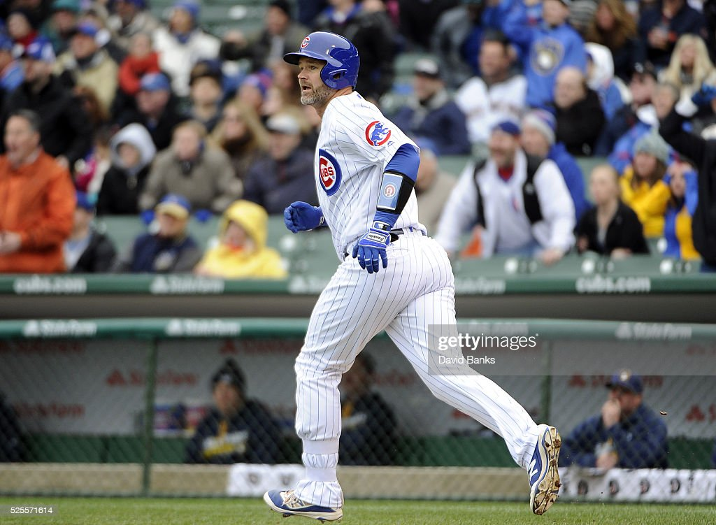 <a gi-track='captionPersonalityLinkClicked' href=/galleries/search?phrase=David+Ross&family=editorial&specificpeople=210843 ng-click='$event.stopPropagation()'>David Ross</a> #3 of the Chicago Cubs rounds the bases on his home run against the Milwaukee Brewers during the second inning on April 28, 2016 at Wrigley Field in Chicago, Illinois.