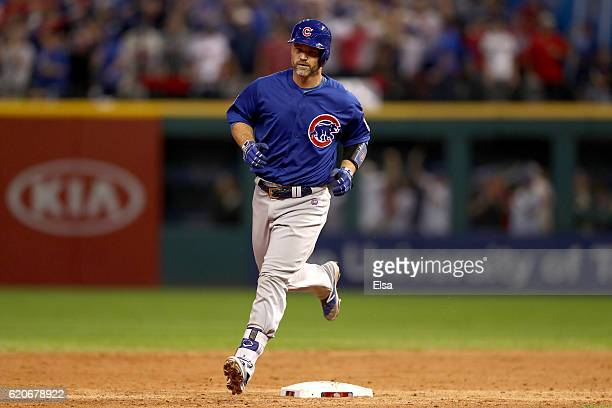 David Ross of the Chicago Cubs runs the bases after hitting a solo home run during the sixth inning against the Cleveland Indians in Game Seven of...