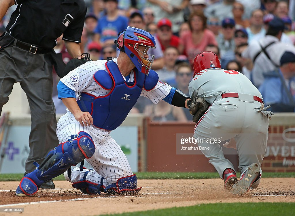 <a gi-track='captionPersonalityLinkClicked' href=/galleries/search?phrase=David+Ross&family=editorial&specificpeople=210843 ng-click='$event.stopPropagation()'>David Ross</a> #3 of the Chicago Cubs tags out <a gi-track='captionPersonalityLinkClicked' href=/galleries/search?phrase=Jeff+Francoeur&family=editorial&specificpeople=217574 ng-click='$event.stopPropagation()'>Jeff Francoeur</a> #3 of the Philadelphia Phillies at the plate in the 4th inning at Wrigley Field on July 24, 2015 in Chicago, Illinois.