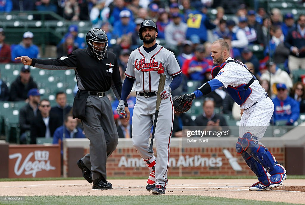 <a gi-track='captionPersonalityLinkClicked' href=/galleries/search?phrase=David+Ross&family=editorial&specificpeople=210843 ng-click='$event.stopPropagation()'>David Ross</a> #3 of the Chicago Cubs tags out <a gi-track='captionPersonalityLinkClicked' href=/galleries/search?phrase=Nick+Markakis&family=editorial&specificpeople=614708 ng-click='$event.stopPropagation()'>Nick Markakis</a> #22 of the Atlanta Braves after striking out in the first inning at Wrigley Field on April 29, 2016 in Chicago, Illinois.