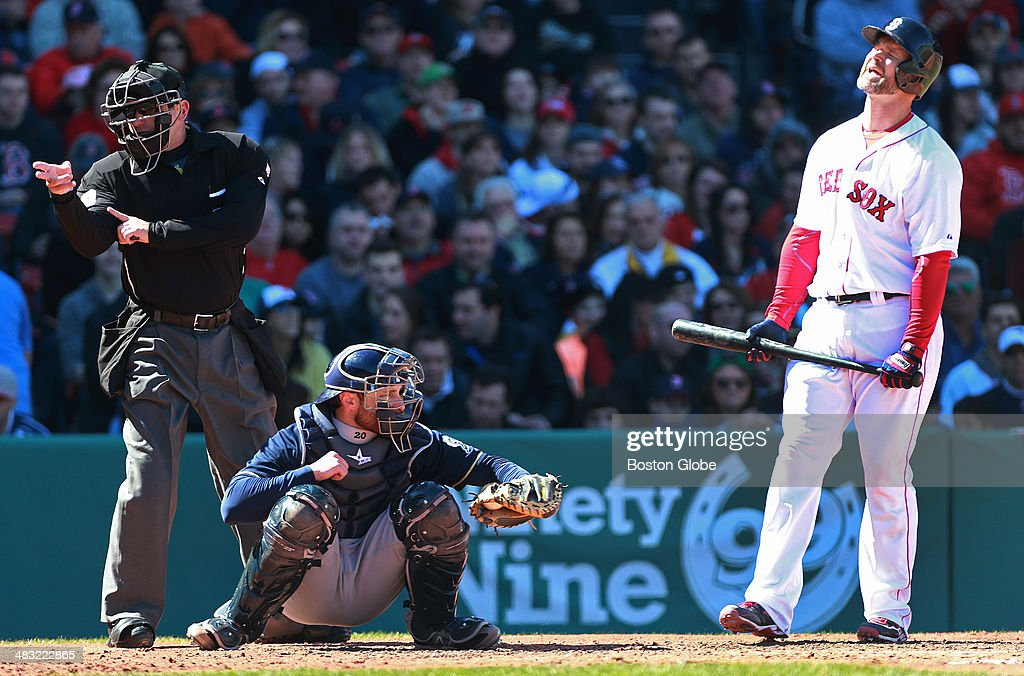 David Ross right reacts to a strike call from umpire Clint Fagan left in the third inning Milwaukee catcher Jonathan Lucroy has the ball in the...