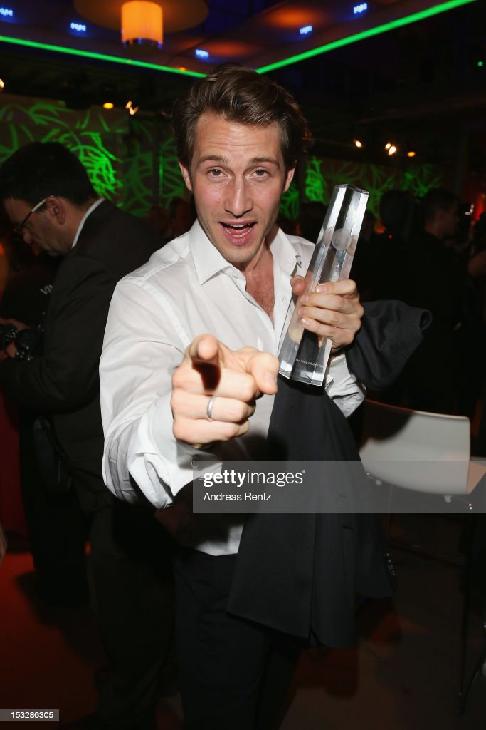 David Rott holds up his award during the German TV Award party 2012 (Deutscher Fernsehpreis 2012) at Coloneum on October 2, 2012 in Cologne, Germany.