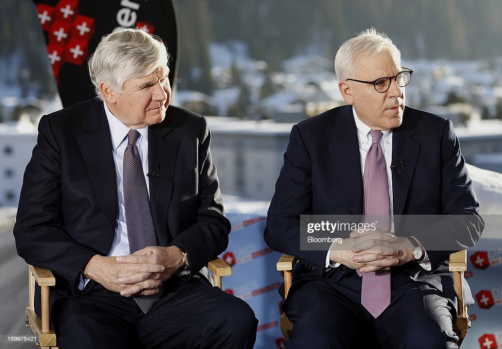 David Rubenstein, co-chief executive officer of Carlyle Group LP, right, and William Conway, co-founder of Carlyle Group LP, pause during a Bloomberg Television interview on day two of the World Economic Forum (WEF) in Davos, Switzerland, on Thursday, Jan. 24, 2013. World leaders, influential executives, bankers and policy makers attend the 43rd annual meeting of the World Economic Forum in Davos, the five day event runs from Jan. 23-27. Photographer: Simon Dawson/Bloomberg via Getty Images