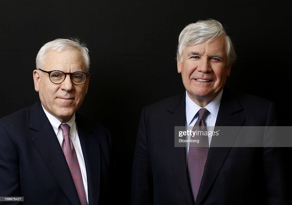 David Rubenstein, co-chief executive officer of Carlyle Group LP, right, and William Conway, co-founder of Carlyle Group LP, pose for a photograph following a Bloomberg Television interview on day two of the World Economic Forum (WEF) in Davos, Switzerland, on Thursday, Jan. 24, 2013. World leaders, influential executives, bankers and policy makers attend the 43rd annual meeting of the World Economic Forum in Davos, the five day event runs from Jan. 23-27. Photographer: Simon Dawson/Bloomberg via Getty Images