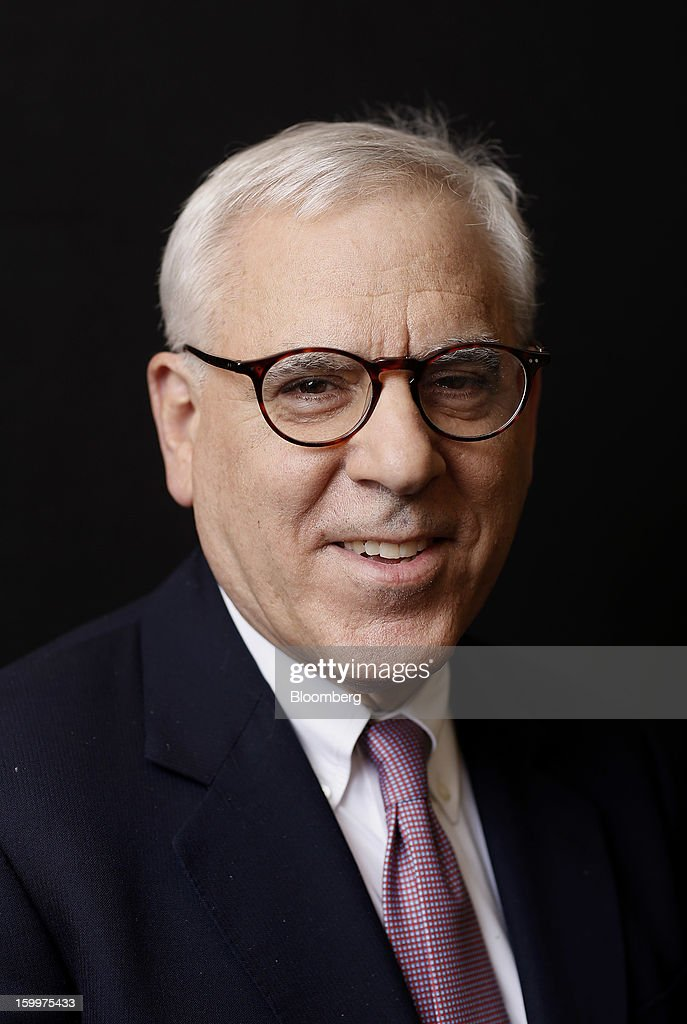 David Rubenstein, co-chief executive officer of Carlyle LP, poses for a photograph following a Bloomberg Television interview on day two of the World Economic Forum (WEF) in Davos, Switzerland, on Thursday, Jan. 24, 2013. World leaders, influential executives, bankers and policy makers attend the 43rd annual meeting of the World Economic Forum in Davos, the five day event runs from Jan. 23-27. Photographer: Simon Dawson/Bloomberg via Getty Images