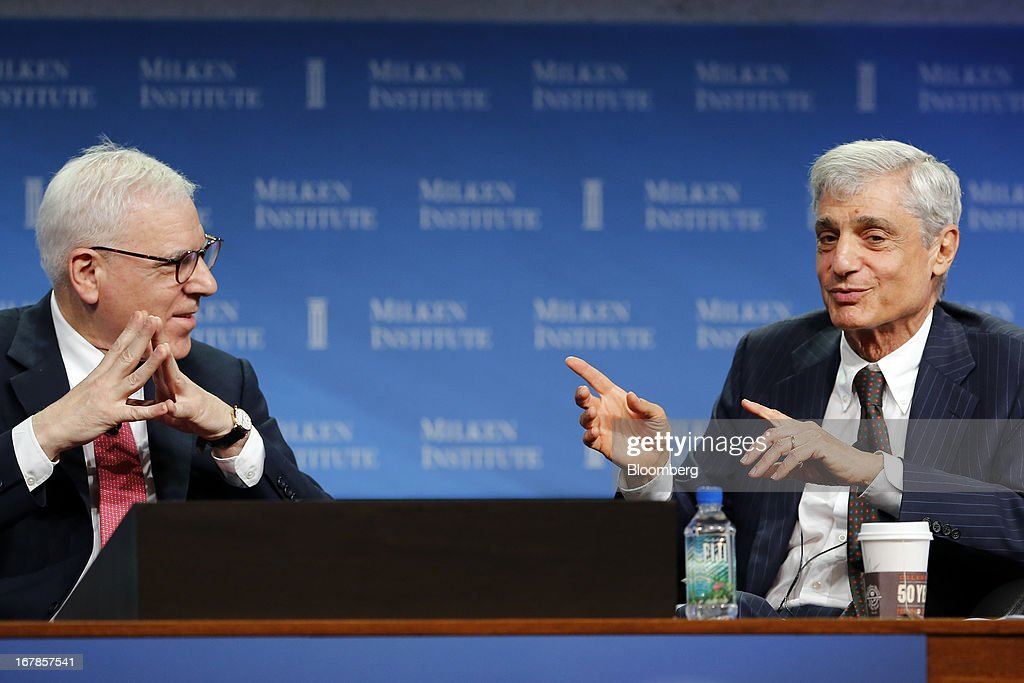 David Rubenstein, co-founder and co-chief executive officer at The Carlyle Group LP, left, talks with <a gi-track='captionPersonalityLinkClicked' href=/galleries/search?phrase=Robert+Rubin&family=editorial&specificpeople=209190 ng-click='$event.stopPropagation()'>Robert Rubin</a>, co-chairman at the Council of Foreign Relations and former U.S. Treasury Secretary, at the annual Milken Institute Global Conference in Beverly Hills, California, U.S., on Tuesday, April 30, 2013. The Global Conference convenes chief executive officers, senior government officials and leading figures in the global capital markets to explore solutions to today's most pressing challenges in business, health, government and education. Photographer: Patrick T. Fallon/Bloomberg via Getty Images