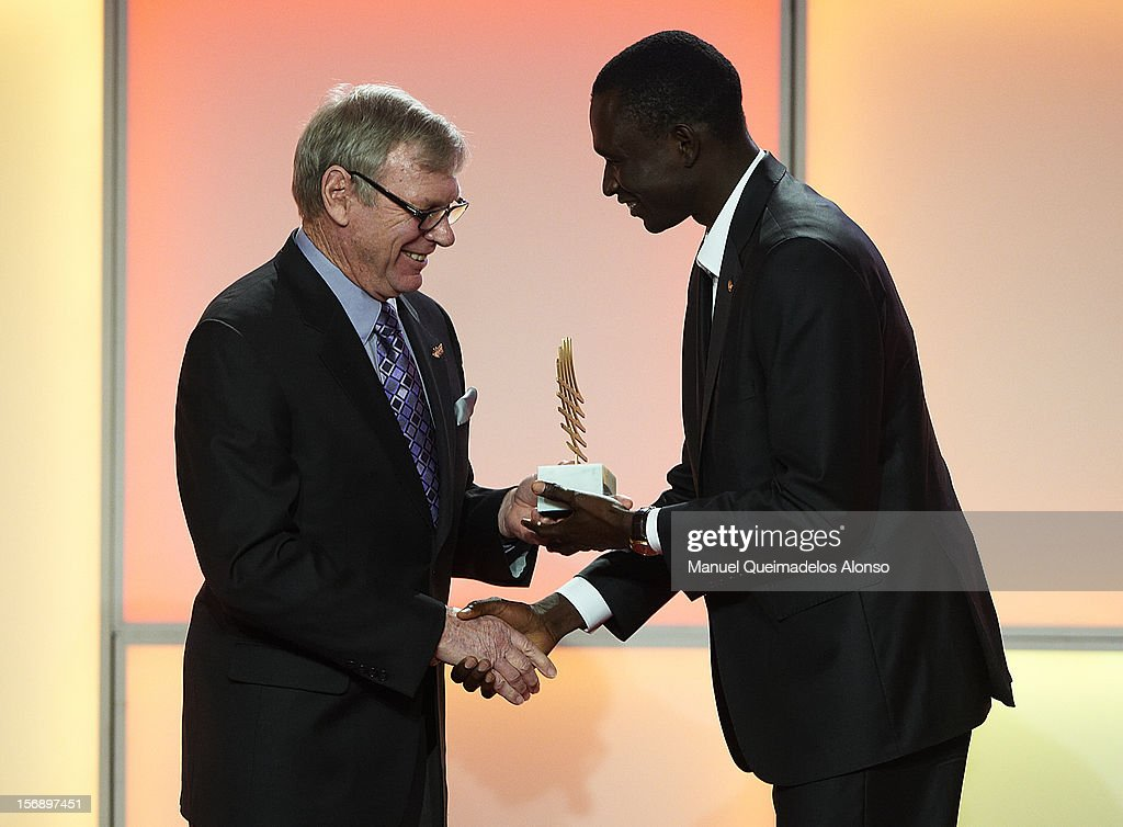 David Rudisha (R) of Kenya receives the male performance of the year award from Peter Snell during the IAAF athlete of the year awards at the IAAF Centenary Gala on November 24, 2012 in Barcelona, Spain.