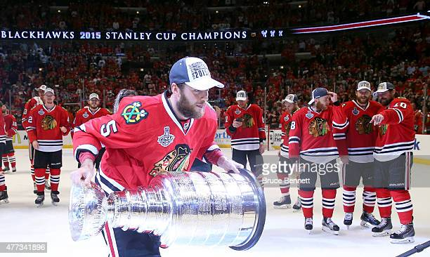 David Rundblad of the Chicago Blackhawks celebrates with the Stanley Cup after defeating the Tampa Bay Lightning by a score of 20 in Game Six to win...
