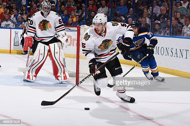 David Rundblad of the Chicago Blackhawks handles the puck against the St Louis Blues on April 9 2015 at the Scottrade Center in St Louis Missouri