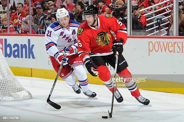 David Rundblad of the Chicago Blackhawks handles the puck as Derek Stepan of the New York Rangers follows in the second period during the season...