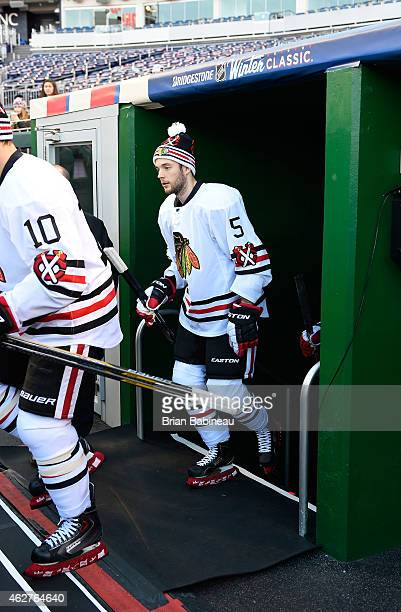 David Rundblad of the Chicago Blackhawks makes his way out of the locker room toward the ice surface for practice prior to the 2015 Bridgestone NHL...