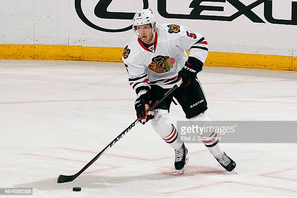 David Rundblad of the Chicago Blackhawks skates with the puck against the Florida Panthers at the BBT Center on February 26 2015 in Sunrise Florida