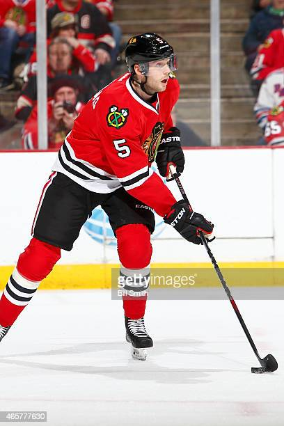 David Rundblad of the Chicago Blackhawks skates with the puck during the NHL game against the New York Rangers on March 08 2015 at the United Center...