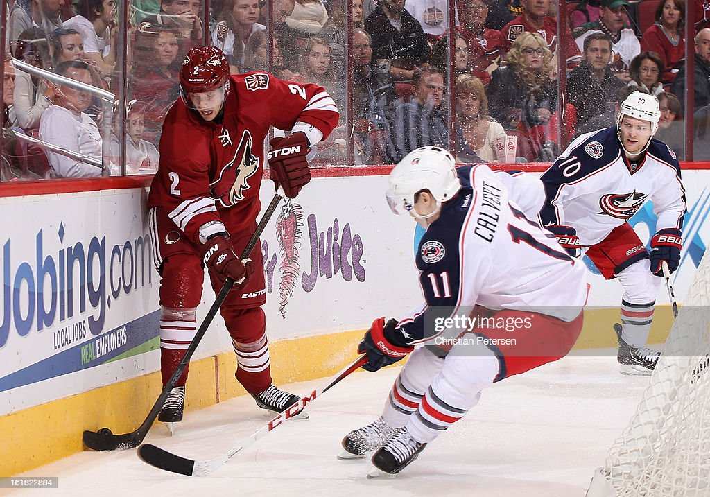 <a gi-track='captionPersonalityLinkClicked' href=/galleries/search?phrase=David+Rundblad&family=editorial&specificpeople=5649675 ng-click='$event.stopPropagation()'>David Rundblad</a> #2 of the Phoenix Coyotes attempts to control the puck under pressure from Matt Calvert #11 of the Columbus Blue Jackets during the third period of the NHL game at Jobing.com Arena on February 16, 2013 in Glendale, Arizona. The Coyotes defeated the Blue Jackets 5-3.