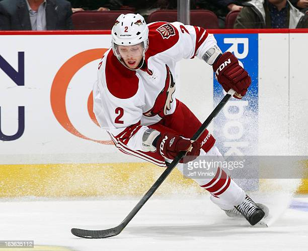David Rundblad of the Phoenix Coyotes skates up ice with the puck during their NHL game against the Vancouver Canucks at Rogers Arena February 26...