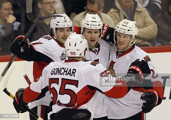 David Rundblad Sergei Gonchar Zack Smith and Erik Condra of the Ottawa Senators celebrate the game winning power play goal by Smith at 1345 of the...