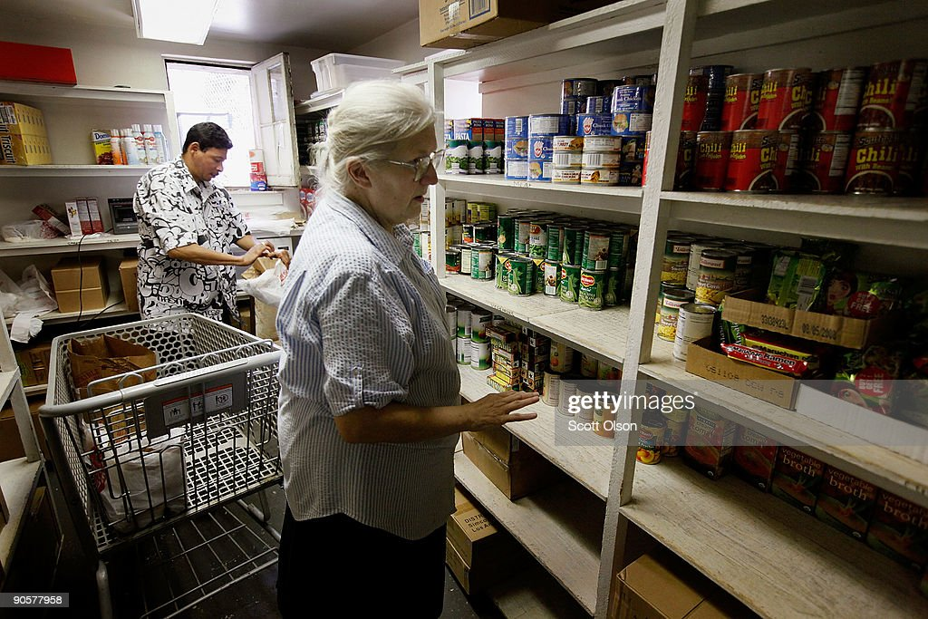 David Salgado (L) and Pat Kuhlman prepare food baskets to give away to needy people at Elijah's Pantry on September 10, 2009 in Chicago, Illinois. According to a government report released today the nation's poverty level jumped to an 11-year high in 2008 as household incomes sank and the number of people without health insurance rose. Elijah's food pantry has seen the number of food baskets it gives away each month climb from 300 to 500 in the past year.