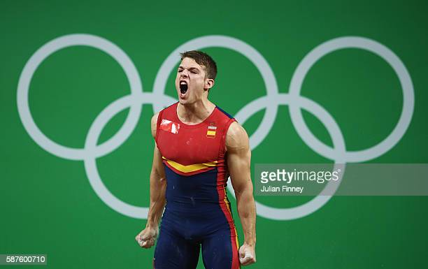 David Sanchez Lopez of Spain reacts during the Men's 69 kg Group B Weightlifting contest on Day 4 of the Rio 2016 Olympic Games at the Riocentro...