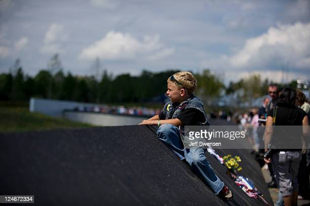 David Sanders of Greensburg Pennsylvania sits along the concourse wall overlooking the crash site of Flight 93 during the ceremony marking the 10th...
