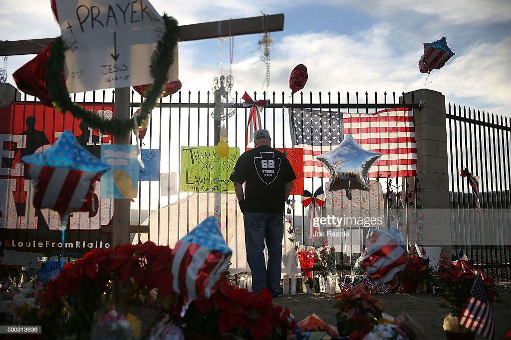 David Santos visits a make shift memorial for those killed and injured setup near the Inland Regional Center on December 7, 2015 in San Bernardino, California. Law enforcement officials continue to investigate the mass shooting at the Inland Regional Center in San Bernardino that left 14 people dead and another 17 injured on December 2nd.