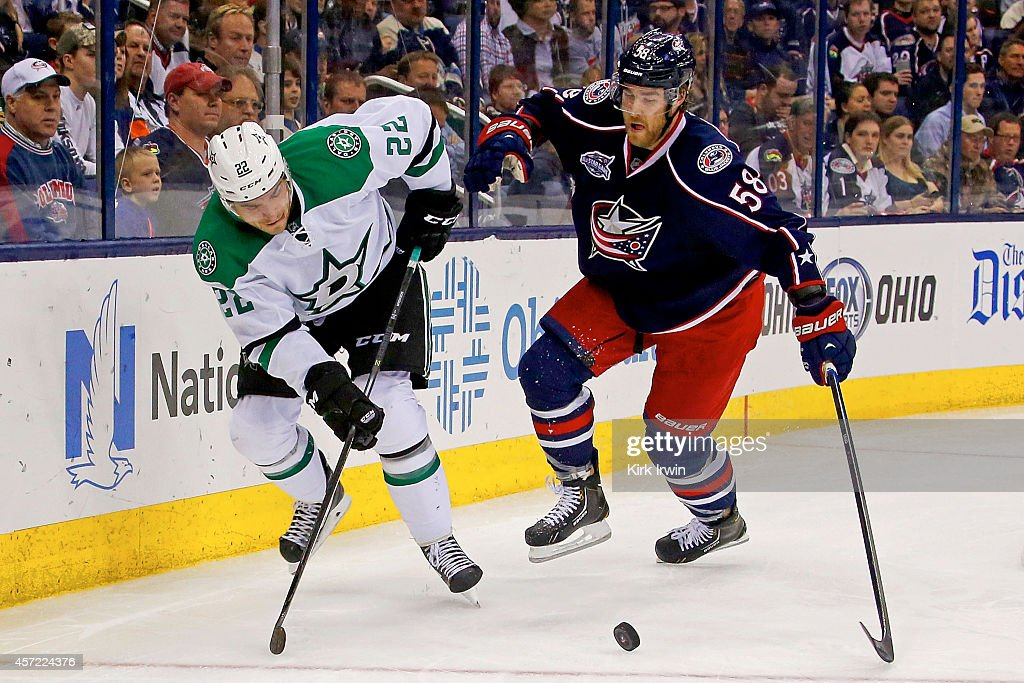 David Savard #58 of the Columbus Blue Jackets and Colton Sceviour #22 of the Dallas Stars battle for control of the puck during the third period on October 14, 2014 at Nationwide Arena in Columbus, Ohio. Dallas defeated Columbus 4-2.